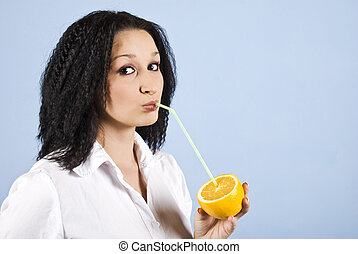 Beauty teen girl drink orange fresh juice