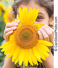 Beauty teen girl with sunflower