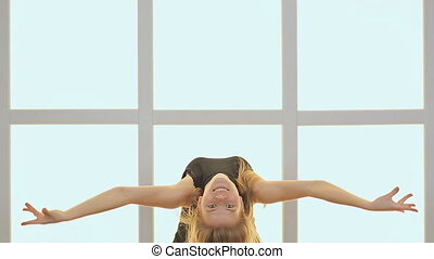 Beauty Teenage Girl Dancing. Against the background of a window in the form of a cage, cubes and squares. Joyful Teen Girl. Song. Hairstyle.