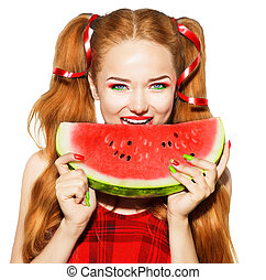 Beauty teenage model girl eating watermelon