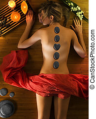 beauty term - cute woman relaxing herself in a spa with a...