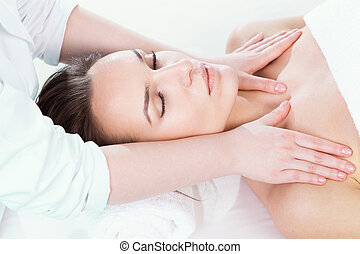 Beautiful woman getting beauty spa treatment and relaxing
