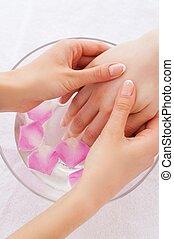 Beauty treatment. Close-up of massage therapist massaging...