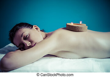 Beauty treatment concept. Masseur doing massage on woman body in the spa salon.