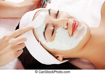 Beauty treatment in spa salon.