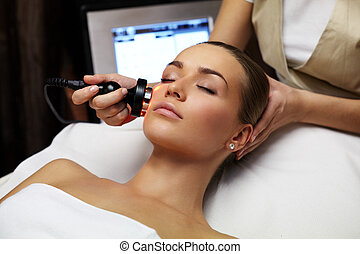 Beauty treatment - Woman lies on a table in a beauty spa...