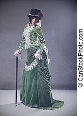 beauty, vrouw, met, stok, vervelend, gevormd oud, jurkje