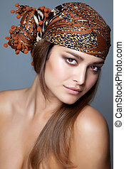 Beauty with a head scarf - Close-up portrait of a beautiful ...