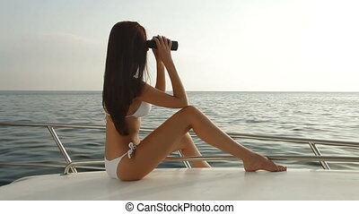 Beauty With Binoculars on Yacht