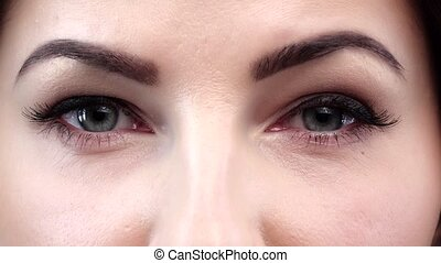Beauty with perfect natural makeup blinking