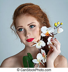 Beauty woman. Beautiful model girl with orchid.