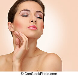 Beauty woman closeup portrait with clean face skin on pink background