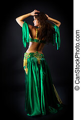 beauty woman dance in green costume