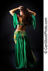 beauty woman dance in green costume