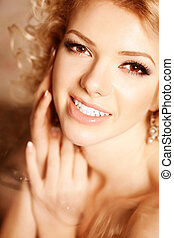 Beauty woman. Face of a young beautiful smiling blondy girl