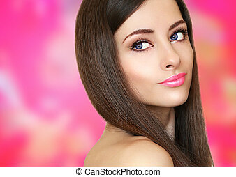 Beauty woman face on pink bright background looking. Closeup portrait