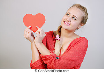 beauty woman holding a heart