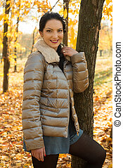 Beauty woman in autumn park