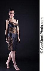 Beauty woman in lacy dress walk on tiptoe