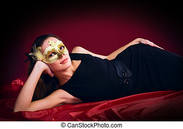 beauty woman in mask on red