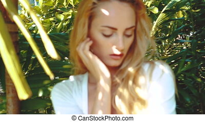 Beauty woman in tropcial garden - Closeup face of stunning...