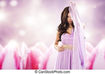 Beauty woman in violet dress.