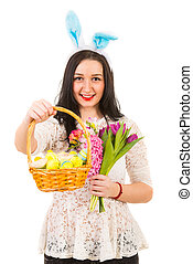 Beauty woman offering basket with Easter eggs