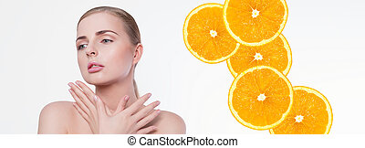 Beauty woman portrait. Beautiful model girl with perfect fresh clean skin, natural professional makeup and oranges on background. Blonde female showing ideal manicure. Youth and skin care concept