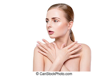 Beauty woman portrait. Beautiful spa model girl with perfect Fresh Clean Skin and natural professional makeup. Blonde female crossing hands showing ideal manicure. Youth and Skin Care Concept. Over white background