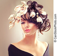Beauty woman portrait. Fashion brunette girl with magnolia flowers hairstyle