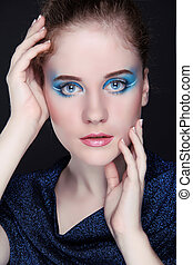 Beauty woman portrait of teen girl with eyes make up, fashion style