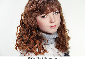 Beauty woman portrait of teen girl with long curly brown hair and clean skin