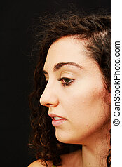 Beauty Woman Portrait over Black Background