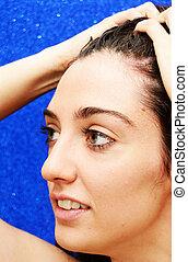 Beauty Woman Portrait over Blue Background
