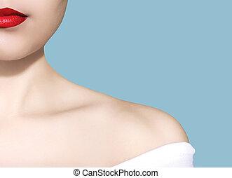 Beauty woman portrait white skin red lips closeup over blue background studio photo