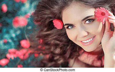 Beauty woman portrait with flowers. Free Happy Girl Enjoying Nature. Beauty teen over marigold flowers field. Outdoor. Wellness.