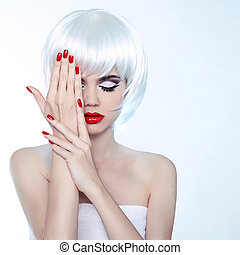 Beauty Woman portrait with makeup and red nail polish, studio shot