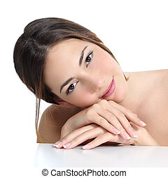 Beauty woman portrait with perfect skin and french manicure in hands