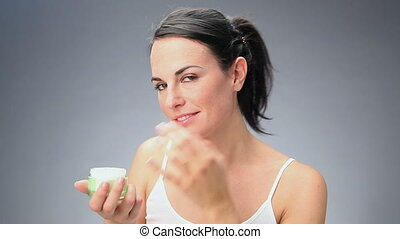 woman putting cream on hands. 30 fps