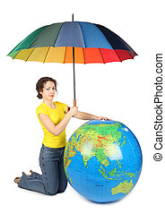 beauty woman sitting and holding umbrella under big inflatable globe, isolated on white