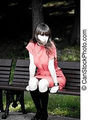 Beauty Woman Sitting On A Park Bench