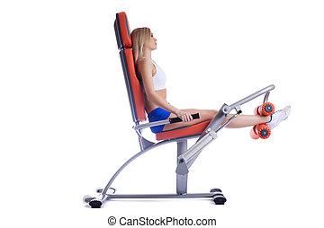 Beauty woman sitting on orange hydraulic exerciser