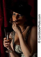 Beauty woman smoking in night