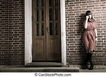 Beauty Woman Standing Against Brick Building