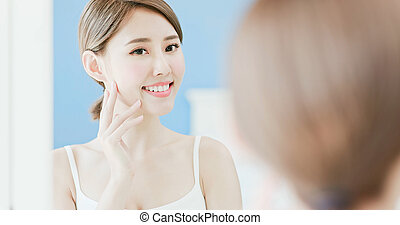 beauty woman touch her face