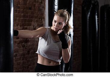 Beauty woman training boxing