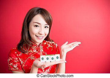 beauty woman wear cheongsam and show mahjong to you in...