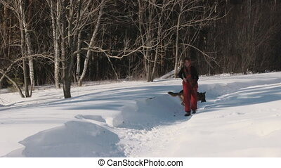 Beauty woman with dog in winter country