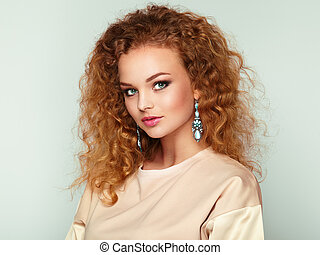 Beauty woman with long and shiny curly hair