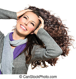 Beauty Woman with Long Curly Hair. Healthy Blowing Hair